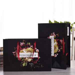 Luxury Handle Paper Clothes Shopping Bag Supplier