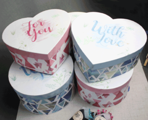 Round heart-shaped paper box for the Valentine's Day and the New Year gift packaging